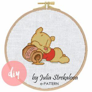 "The cross-stitch pattern with pretty sleeping bear ""Winnie the pooh""."