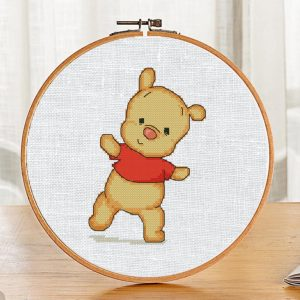 """The cross-stitch pattern with pretty funny bear """"Winnie the pooh""""."""