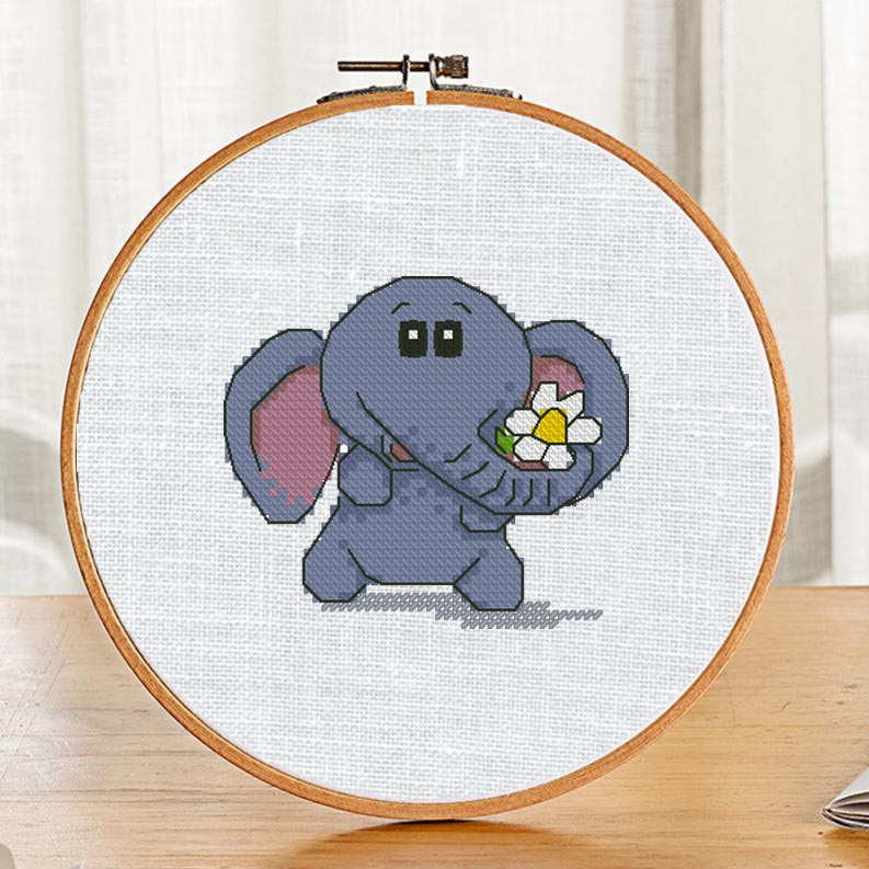 "The free small cross-stitch pattern ""Elephant and flower"" for beginners."