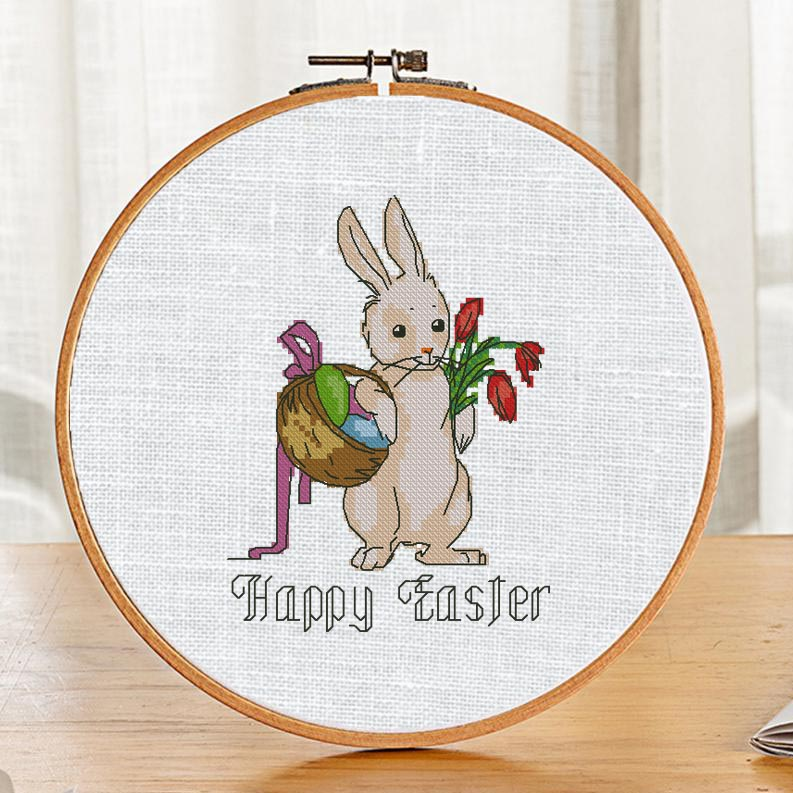 "The free printable pdf cross-stitch pattern ""Easter Bunny John"" in modern style."