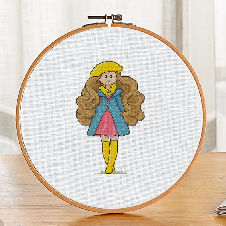 """The free small cross-stitch pattern """"Rhianna Doll"""". It can be used for gift or home decor. It is suitable for hoop art. Just add any sign and you'll get a personalized gift."""