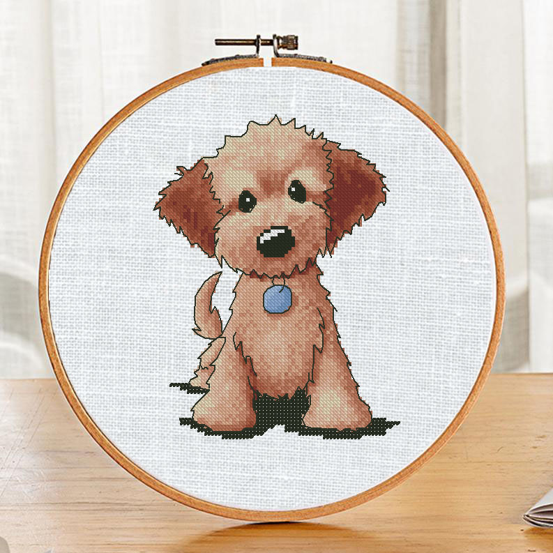 "The free printable cross-stitch pattern ""Dog Blue Pendant"" in modern style. It can be used for gift or cloth decor. It is suitable for hoop art."