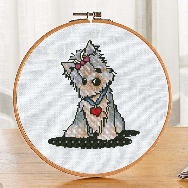 "The free printable cross-stitch pattern ""Yorkie Dog"" in modern style."
