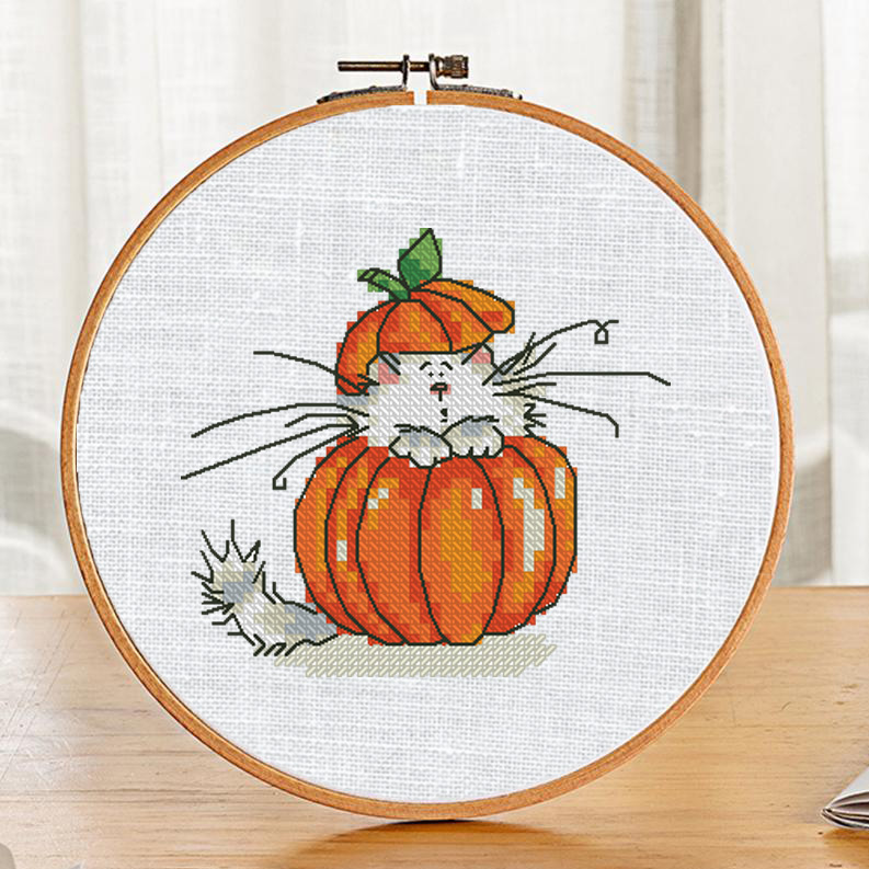 "The free printable small and easy cross-stitch pattern with pretty ""Pumpkin Cat"" in modern style. It can be used for gift or home decor. It is suitable for hoop art."