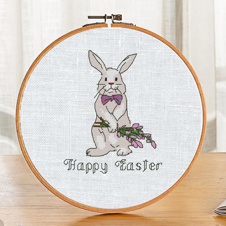 "The free printable pdf cross-stitch pattern ""Easter Bunny David"" in modern style."