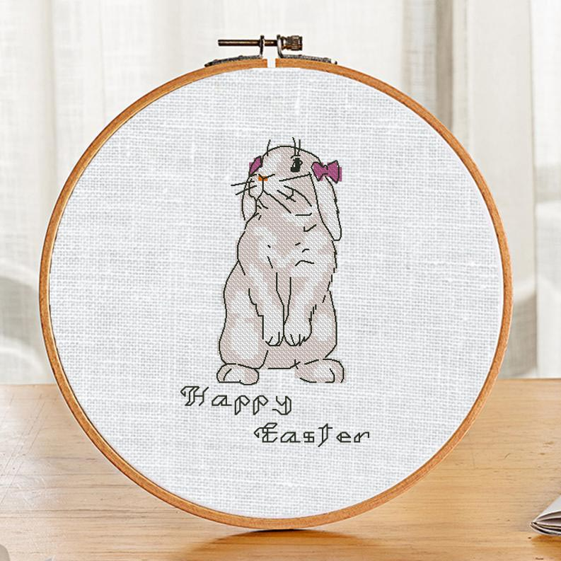 "The free printable pdf cross-stitch pattern ""Easter Bunny Samanta"" in modern style."