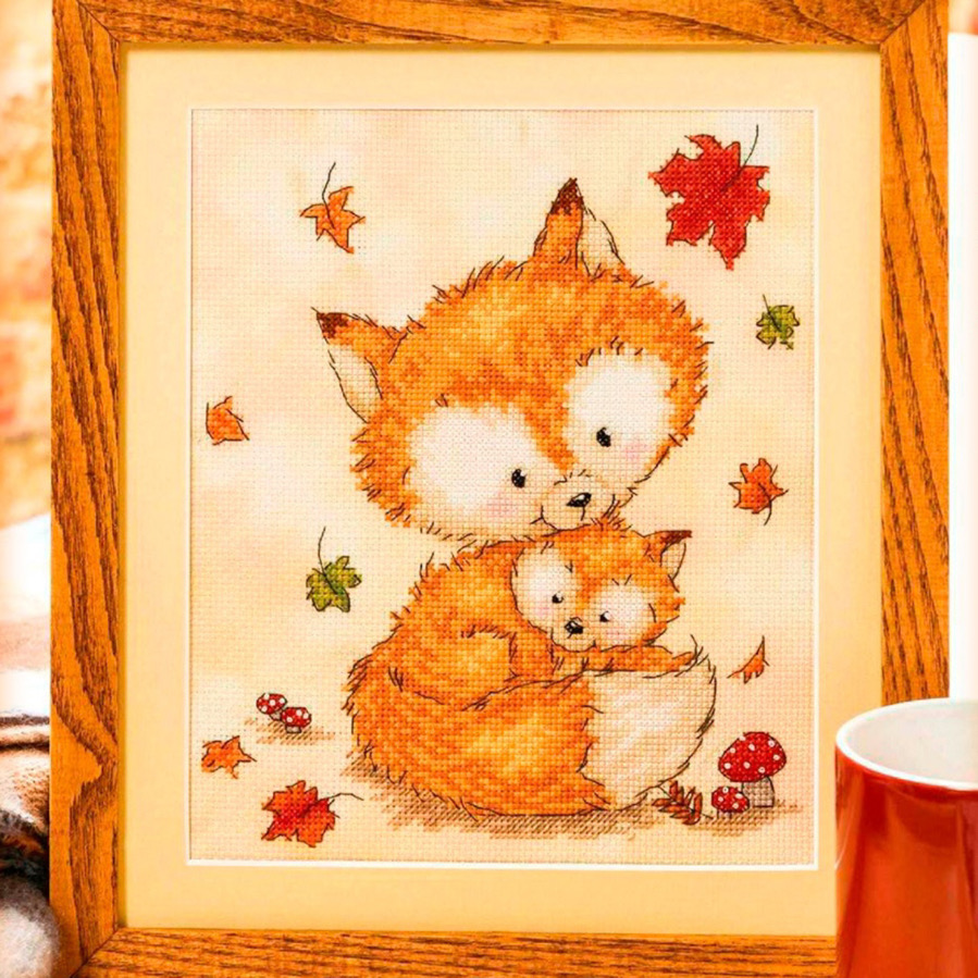 Free cross stitch pattern with a cute little fox